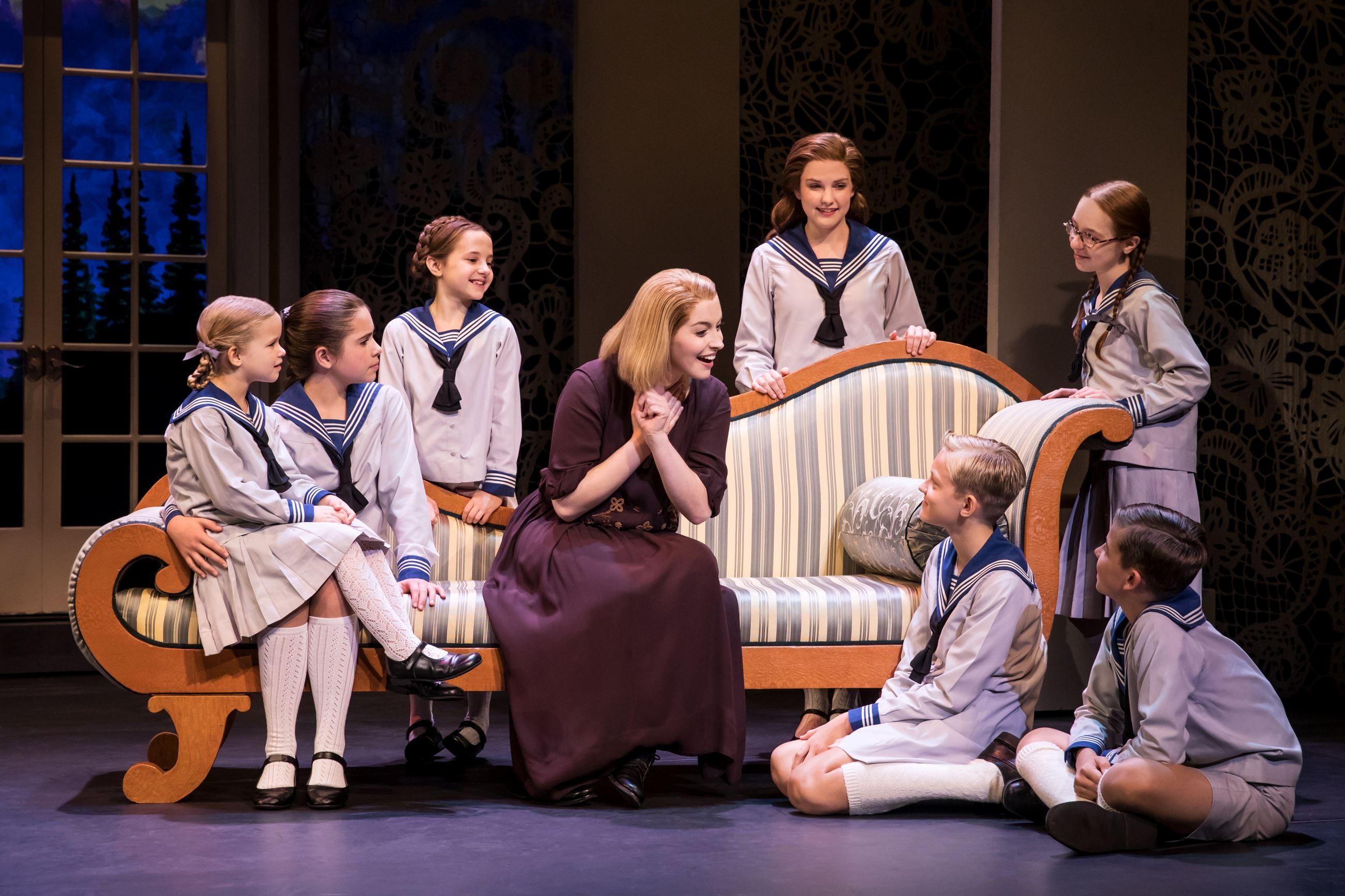 Jill-Christine Wiley as Maria Rainer and the von Trapp children. Photo by Matthew Murphy